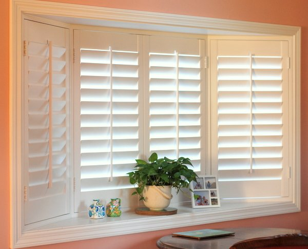Plantation shutters work well in a bay window.